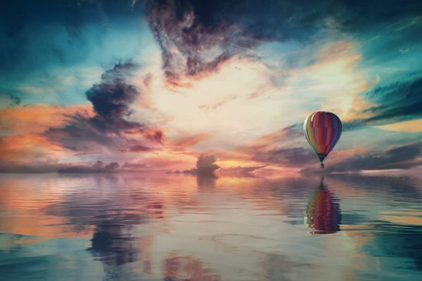 Landscape clouds with hot air balloon